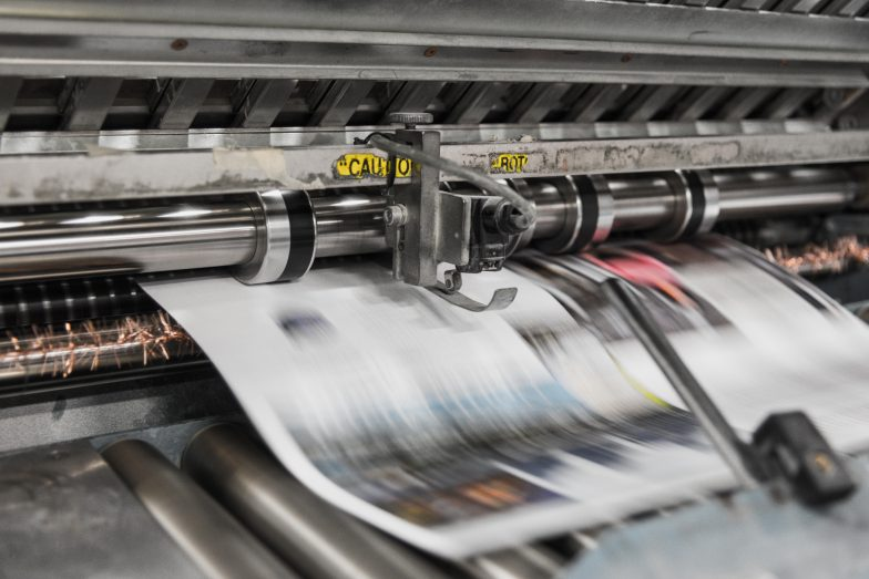 Newspapers roll off the presses
