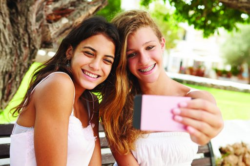 Two young girls taking a picture