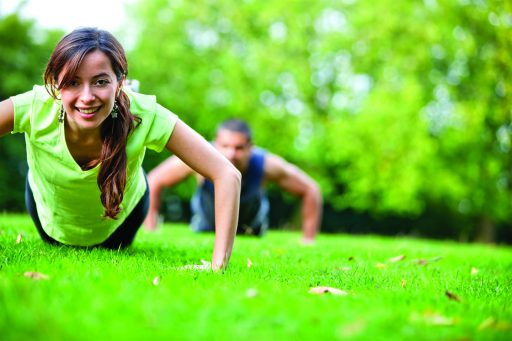 A female and male exercising outside