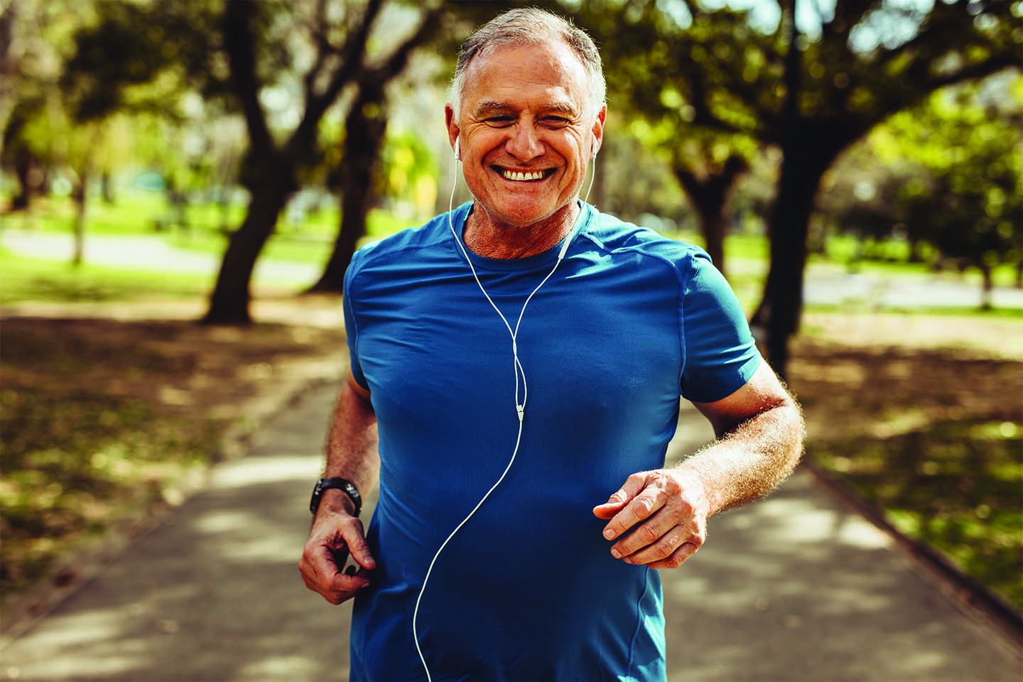 Older man running and smiling