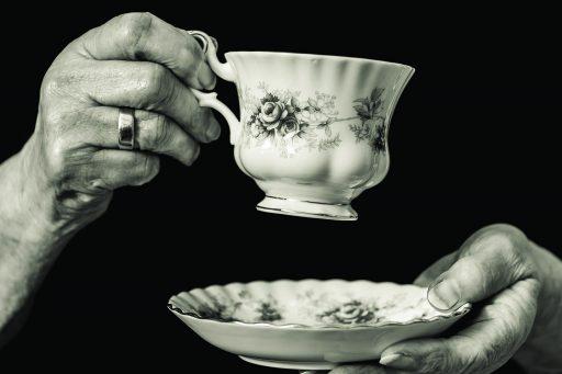 Elderly women holding a cup of tea