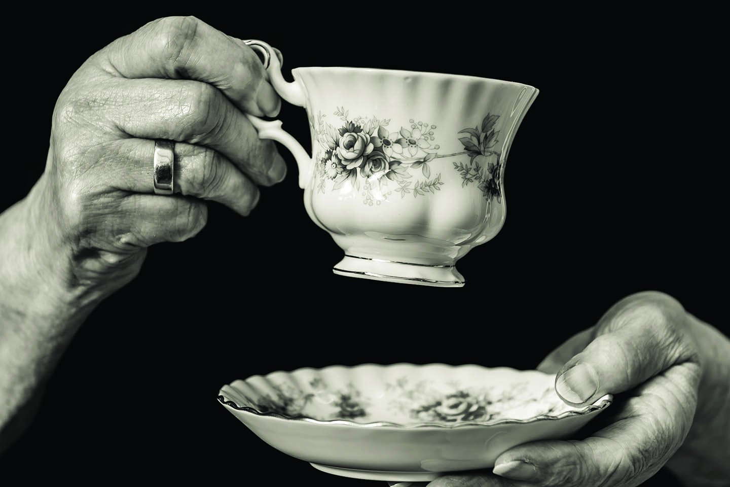 Elderly women holding a cup of tea