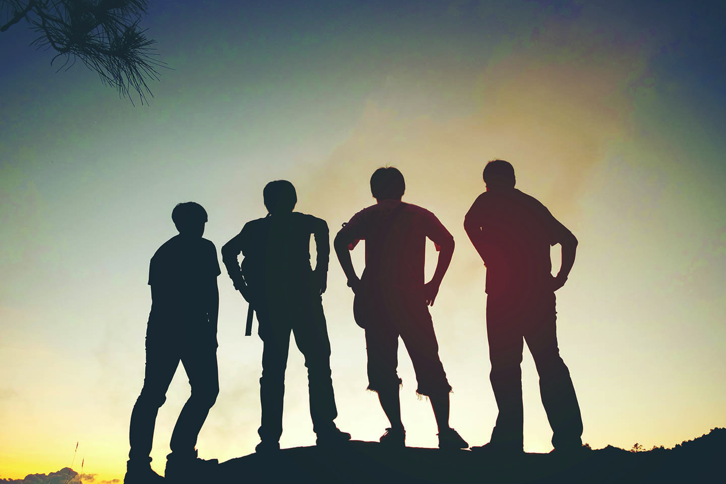 Four teenagers looking at the sunset