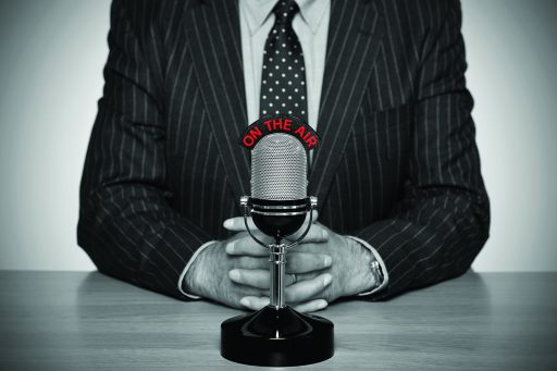 Man in suit talking on the radio