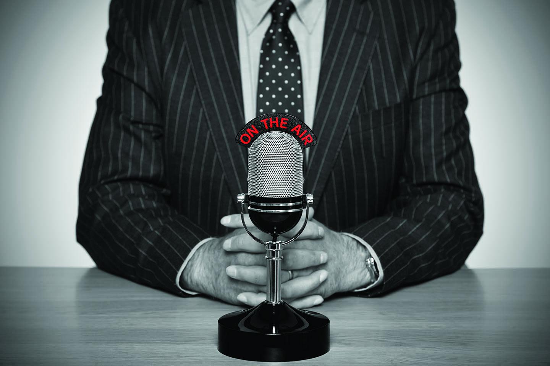 Man in suit talking on the radio